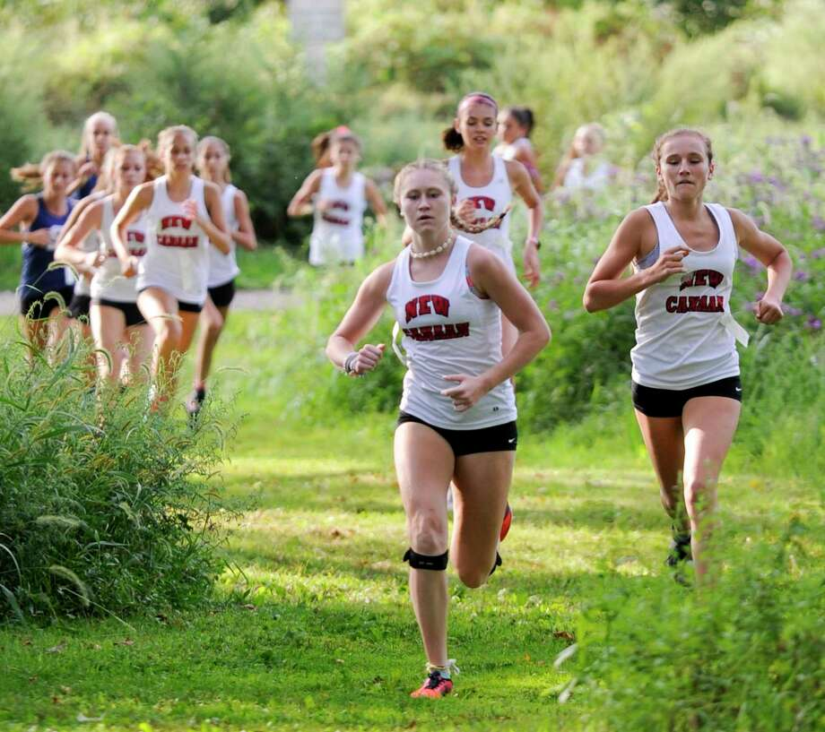 Competitors from Staples, Westhill, St. Joseph and New Canaan compete in an FCIAC cross country quad meet at Waveny Park in New Canaan, Connecticut on Sept. 10, 2019. Photo: Matthew Brown / Hearst Connecticut Media / Stamford Advocate