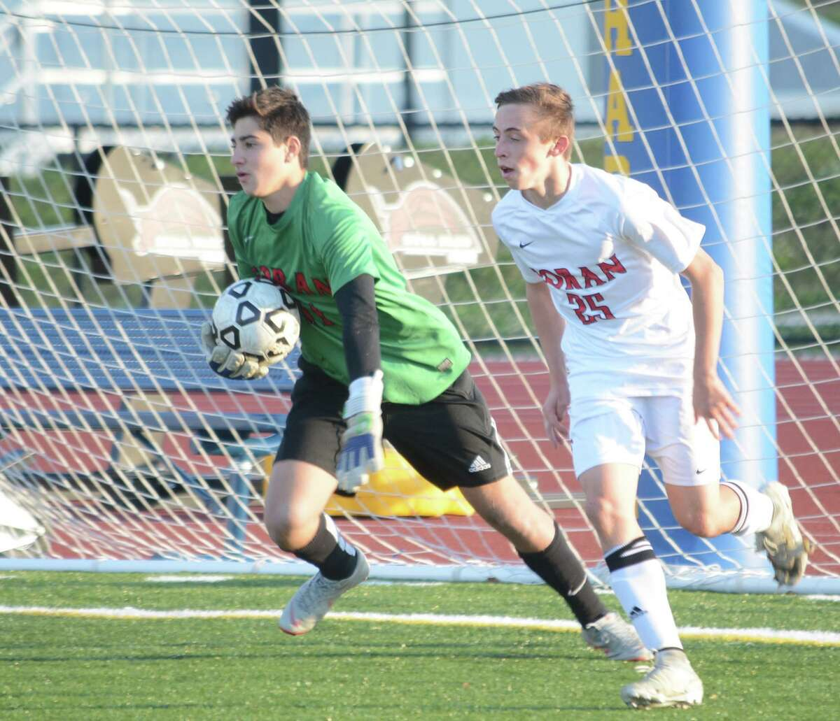 Luca Marinelli, flanked by Thomas Kummer, will be in goal for Foran High when it opens its season.