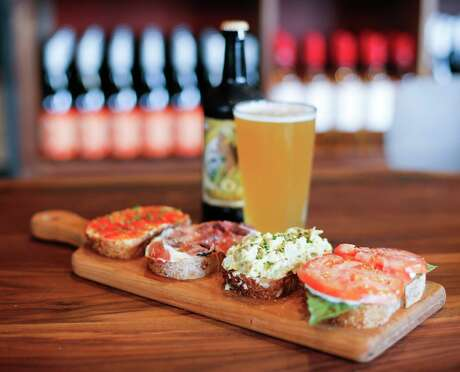 The bruschetta feature, from left spicy pepper jam, prosciutto & fig, artichoke and traditional at Postino WineCafe on Tuesday, Sept. 10, 2019 in Houston. The restaurant and wine shop will open next week in Montrose, the former home of the Montrose Mining Company, Houston's longest-running gay bar. Postino's owner has created a preservation-minded design that pays homage to the spirit of the neighborhood.