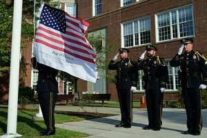 The Norwalk Police Department Honor Guard raises the new colors honoring the victims of September 11 2001 as The City of Norwalk holds a remembrance event to honor the 14 Norwalk residents who lost their lives during the September 11, 2001 attacks and all of the victims of 9-11 Wednesday, September 11, 2019, in Norwalk, Conn. .