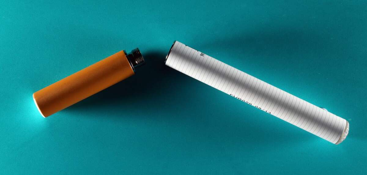 2. SOME VAPING AND E-CIGARETTES ARE EVEN MARKETED TO LOOK LIKE A REAL CIGARETTE TO APPEAL TO ADULTS. A general view of an electronic cigarette which replicates the act of smoking without the use of tobacco. The cigarettes, which run on a rechargeable battery, turn nicotine and other chemicals into an inhalable vapor