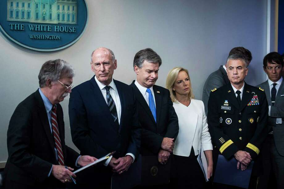From left, national security adviser John Bolton, Director of National Intelligence Daniel Coats, FBI Director Christopher Wray, Secretary of Homeland Security Kirstjen Nielsen and National Security Agency Director Paul Nakasone attend a White House news briefing in August 2018. Only Wray and Nakasone still have their jobs. Photo: Washington Post Photo By Jabin Botsford / The Washington Post