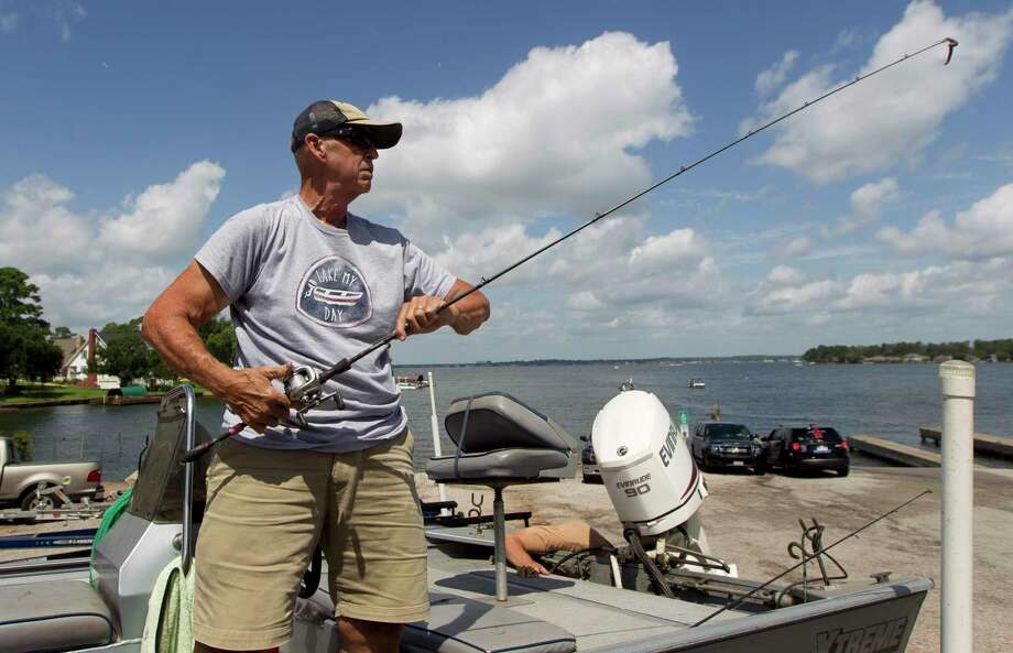 Don Gill of Huffman puts up his fishing reel after a morning on Lake Conroe this past July. Photo: Jason Fochtman, Houston Chronicle / Staff Photographer / Houston Chronicle