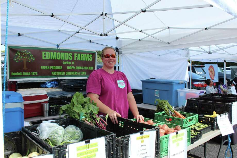 The Woodlands Farmers Market, hosted in The Village of Grogan's Mill, is rocking and rolling into fall as the season for fresh produce heats up and new vendors join the market. Susan Edmonds of Edmonds Farm in Spring is a regular at the market, hawking her fresh produce with a smile. The market is located in the parking lot of the village shopping center in The Village of Grogan's Mill, near the intersection of Grogan's Mill Road and South Millbend Drive. It is open from 8 a.m. to noon each Saturday. Photo: Photographs By Jeff Forward/The Villager / Photographs By Jeff Forward/The Houston Chronicle