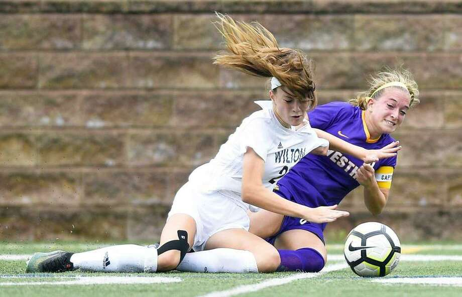 Shelby Dejana (left) battles a Westhill player for the ball during a game last year. Photo: Matthew Brown / Hearst Connecticut Media