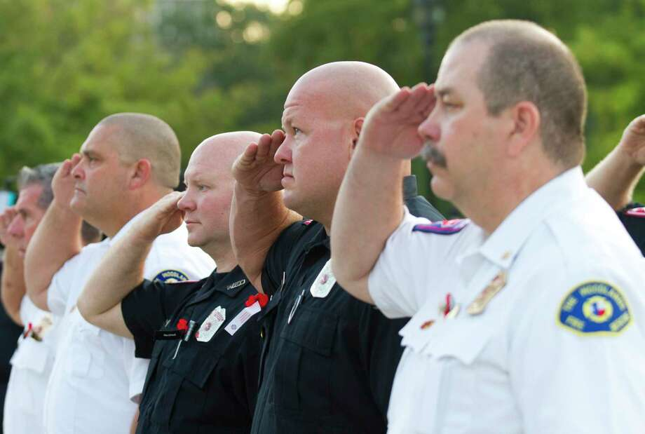 Firefighters salute the American flag during a ceremony in honor of Patriot Day at The Woodlands Central Fire Station on Tuesday, Sept. 11, 2019, in Spring. The event was held in remembrance of the nearly 3,000 victims of the terror attacks on September 11, 2001. Photo: Jason Fochtman, Houston Chronicle / Staff Photographer / Houston Chronicle