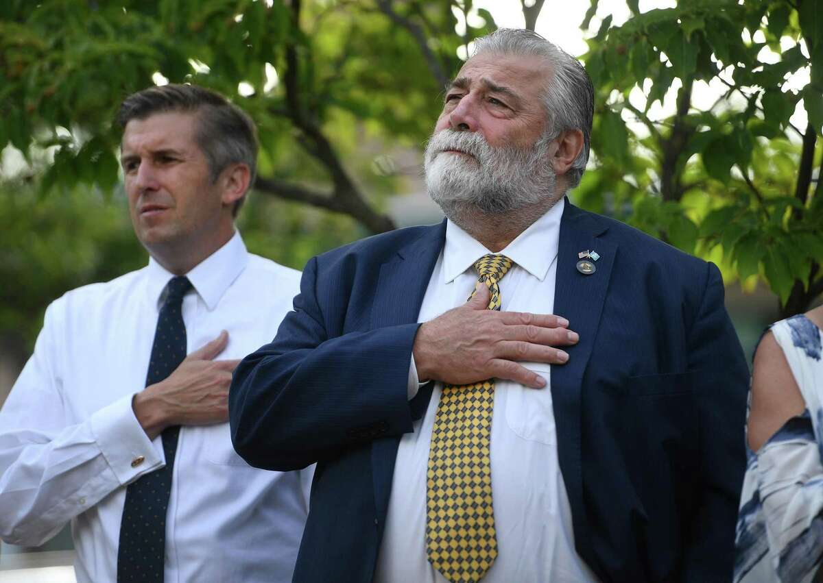 State Sen. James Maroney, left, and State Rep. Charles Ferraro attend the annual Milford Remembers 9/11 ceremony at the Live Oaks School Memorial Garden in Milford, Conn. on Wednesday, September 11, 2019.
