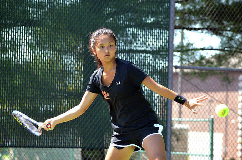 Edwardsville freshman Chloe Koons keeps her eyes on the ball on Saturday during her No. 1 singles match against New Trier 2 in the third-place match of the Heather Bradshaw Memorial Invitational.
