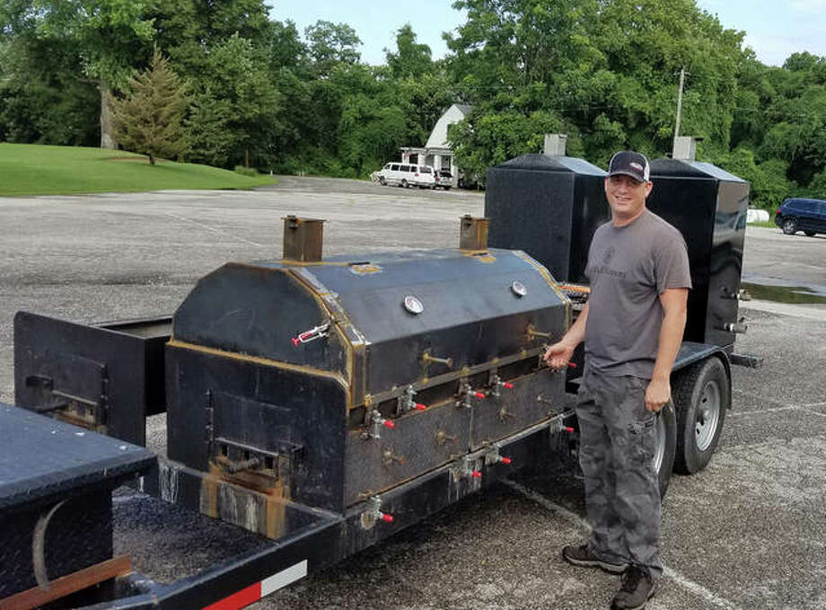 Christian Dornhorst poses with the grill he will use to cook the meat at Saturday's centennial celebration for Edwardsville American Legion Post #199. Photo: For The Intelligencer
