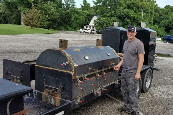 Christian Dornhorst poses with the grill he will use to cook the meat at Saturday's centennial celebration for Edwardsville American Legion Post #199.