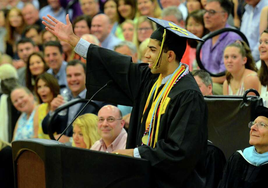 Graduate and Class Valedictorian Manan Manchanda jokingly asks the audience to applaud after every sentence during his address at Trumbull High School's Commencement Exercises in Trumbull, Conn., on Tuesday June 18, 2019. Photo: Christian Abraham / Hearst Connecticut Media / Connecticut Post
