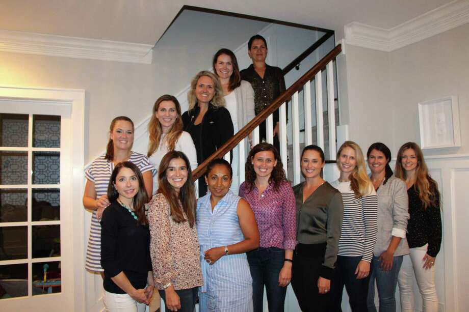 The event committee includes Alyssa Mahoney, bottom, left, Ashley Fisher, Jessenea Leon-Chen, Cristina Paolazzi, Elizabeth Banach, Lauren Capen, Sarah Christensen, and Clare DeSalvo; and Heather Lucas, stairs, left, Ingrid Sarver, Lindsay McGuinn, Ashley Overlander, and Paola Sordoni. Not pictured: Cathy Bailey, Carly Annecchino, Lauren Stevens, Kate Gregory, Ali Ceglarski, Sally Merwin, Tobey Wallace, Meghan Shain, Kelly Meagher, Bethany Armstrong, Gail Kennedy, and Christina Farrell-Danka. Photo: Opus For Person-to-Person