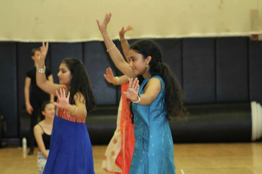 Student dancers in anarkali dresses on dance day during Trumbull High School's World Language Week. Photo: Matt Nusom / Trumbull High School / Trumbull Times Contributed