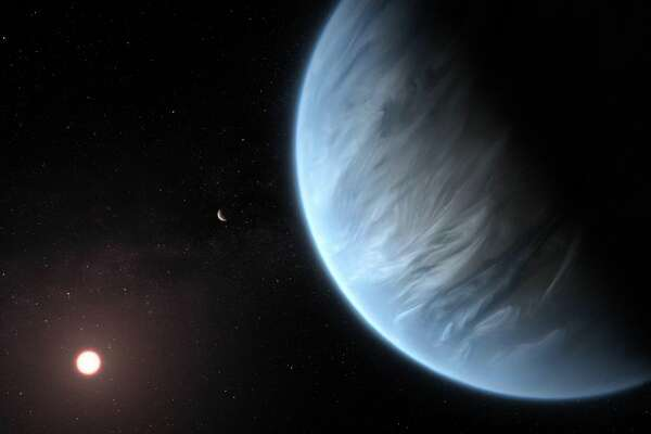An artist's impression shows K2-18b and its host star. The planet has life-friendly temperatures, and it may have water too.