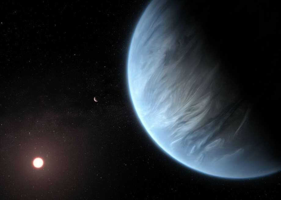 An artist's impression shows K2-18b and its host star. The planet has life-friendly temperatures, and it may have water too. Photo: ESA/Hubble, M. Kornmesser
