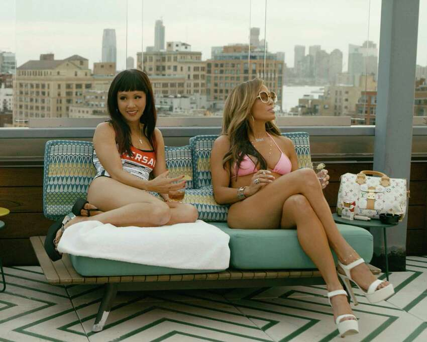 This image released by STXfilms shows Constance Wu and Jennifer Lopez in a scene from