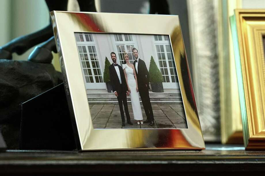 A framed photograph of Donald Trump Jr., Ivanka Trump and Eric Trump sits on a table behind the president's desk in the Oval Office. The plan could have been for the Trumps to capitalize on an Election Day loss to Hillary Clinton in 2016 with their own TV network, a line of clothing and a chain of budget motels. Photo: Chip Somodevilla /Getty Images / 2019 Getty Images