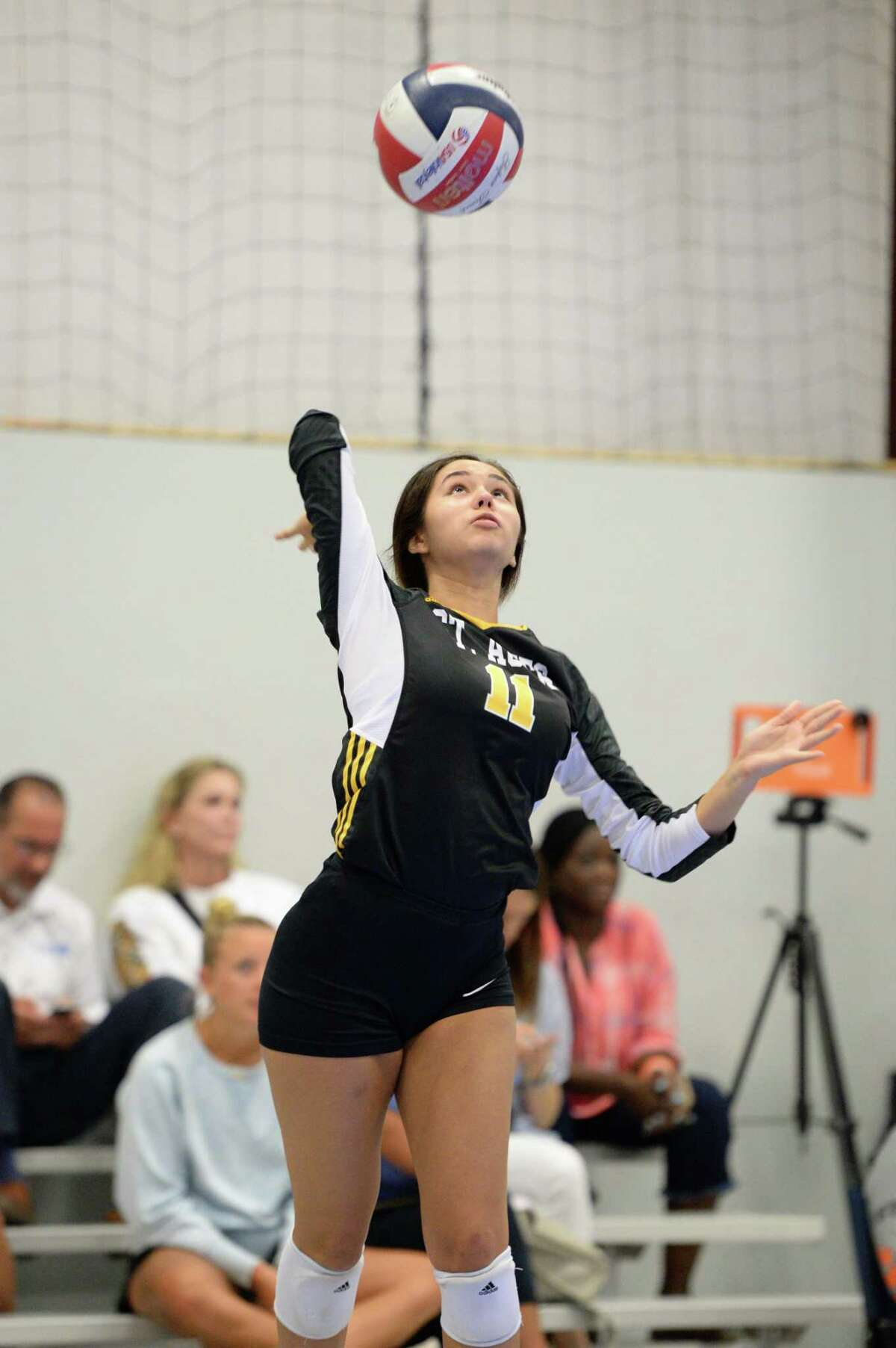 Nicole Dworaczyk (11) of St. Agnes serves during the second set of a volleyball match between the St. Agnes Tigers and the Episcopal Knights JV on Friday, August 23, 2019 at Skyline Juniors, Houston, TX.