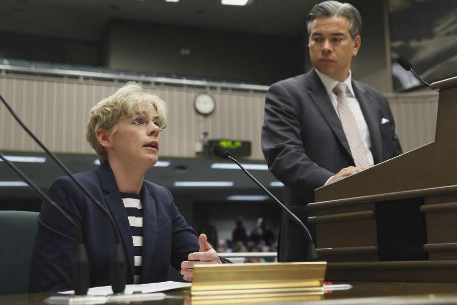 FILE - Jennifer Kent, director of the Department of Health Care Services, answers questions concerning a bill by Assemblyman Rob Bonta, D-Alameda, right, to restructure California's health-plan taxes, during a legislative hearing at the Capitol,   Wednesday, Feb. 10, 2016, in Sacramento. Kent announced Tuesday she was stepping down from her role with the department, a position she has held since 2015.