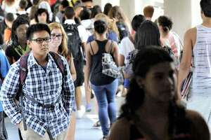 Students in the hallways between classes at Danbury High School,