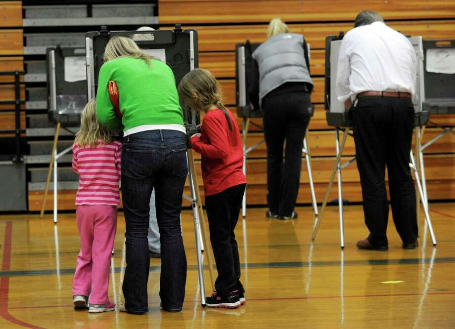 The Yanity Gym, the district three polling place in Ridgefield, Conn., had a steady stream of voters Tuesday, Nov. 4, 2014. Photo: Carol Kaliff / Carol Kaliff / The News-Times