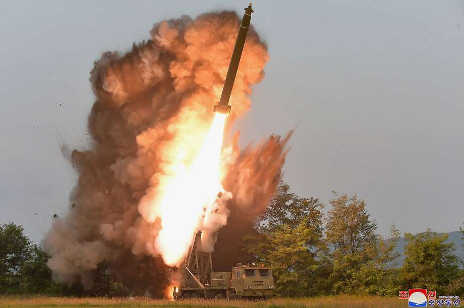 A multiple rocket launcher is test-fired at an undisclosed location in North Korea. Photo: North Korean Government