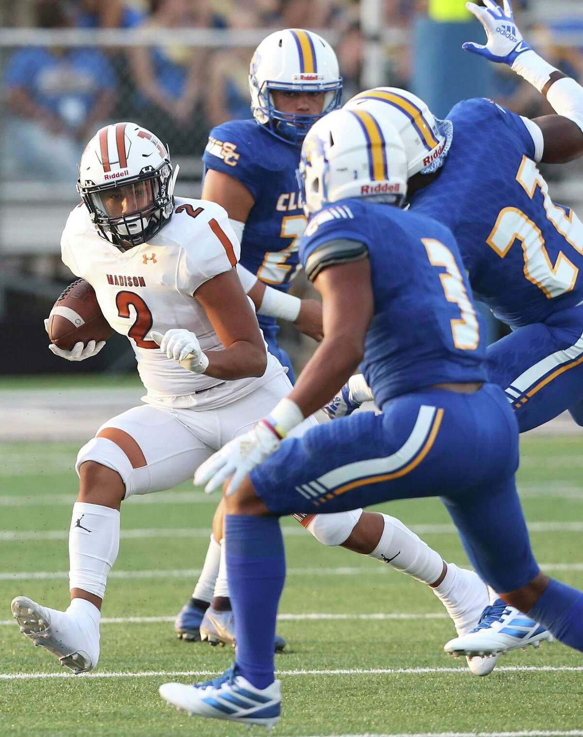 Maverick's halfback Darien Gill tries to slip away from Buffalo pursuers in the first quarter as Clemens hosts Madison at Lehnhoff Stadium on August 30, 2019.