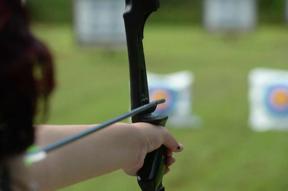 Tyler Ingraham takes aim at her target as members of the SETX Toxophilites, a local archery team that is part of the Junior Olympic Archery Development, practice on the range in Tyrrell Park Saturday..  Photo taken Saturday, August 31, 2019 Kim Brent/The Enterprise Photo: Kim Brent / The Enterprise / BEN