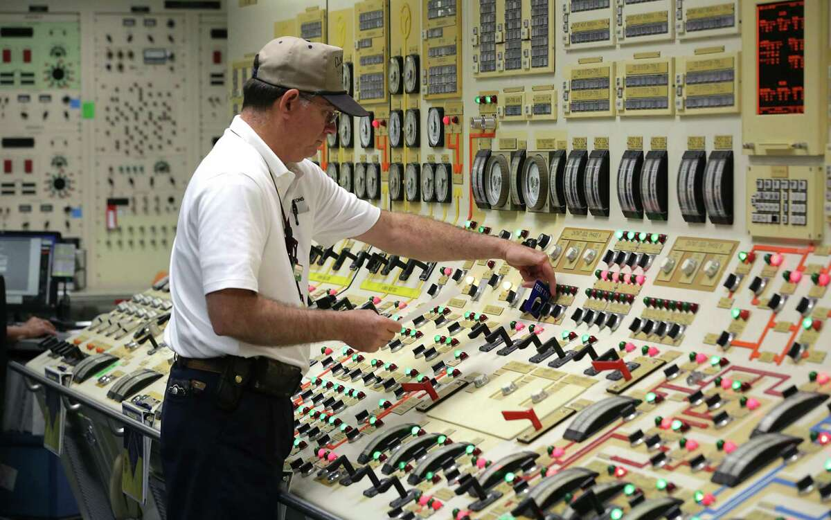 David Clark, Secondary Ractor Operator, makes an adjustment at the South Texas Nuclear Generating Station on Wednesday, Jan. 11, 2017.