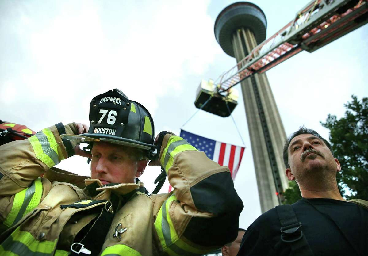 A firefighter from Houston Fire Department prepares to climb the Tower of Americas.