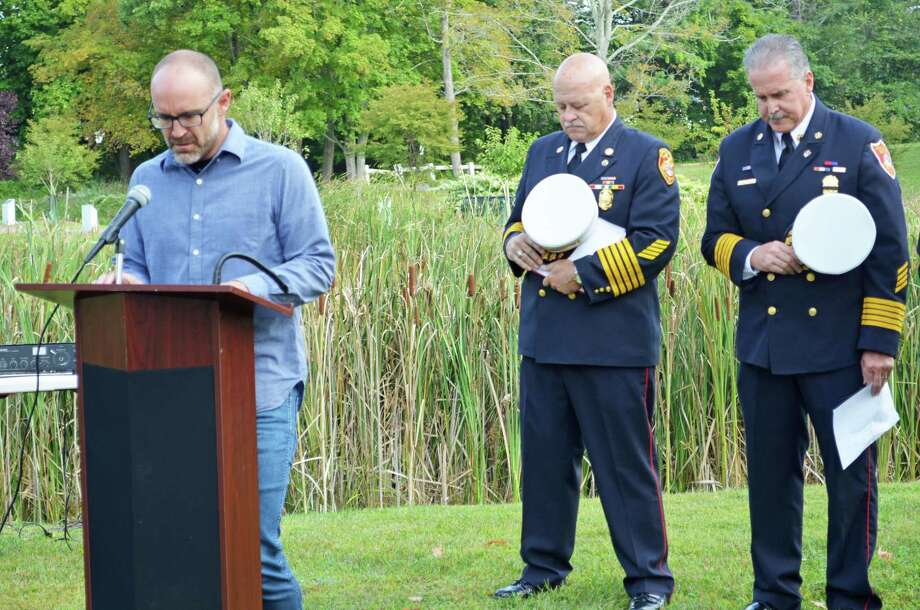 The city of Middletown observed the 18th anniversary of the Sept. 11, 2001, terrorist attacks Wednesday morning at Veterans Memorial Park and Connecticut Trees of Honor. From left are the Rev. Ryan Wetherhead of Vox Church in Middletown, Middletown Fire Chief Robert Kronenberger and South Fire District Chief Michael Howley. Photo: Cassandra Day / Hearst Connecticut Media