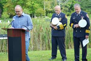 The city of Middletown observed the 18th anniversary of the Sept. 11, 2001, terrorist attacks Wednesday morning at Veterans Memorial Park and Connecticut Trees of Honor. From left are the Rev. Ryan Wetherhead of Vox Church in Middletown, Middletown Fire Chief Robert Kronenberger and South Fire District Chief Michael Howley.