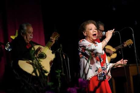 Beatriz Llamas of Las Tesoros de San Antonio sings at a sendoff party for the group Sept. 6 at the Esperanza Peace & Justice Center.