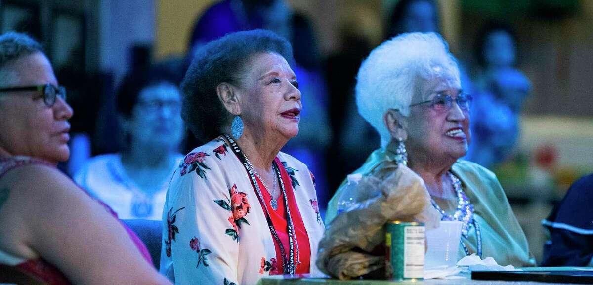 Las Tesoros de San Antonio members Beatriz Llamas (center) and Blanquita Rodriguez accept accolades during the sendoff party in their honor at Esperanza. Among those attending were U.S. Rep Lloyd Doggett.