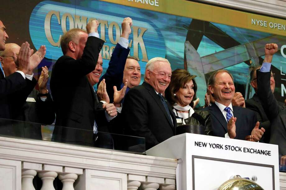 Dallas Cowboys owner, and major stockholder of Comstock Resources Jerry Jones, with wife Gene, is applauded as he rings the New York Stock Exchange opening bell, Wednesday, Sept. 4, 2019. The company is celebrating its $2.2 billion acquisition of Covey Park Energy. (AP Photo/Richard Drew) Photo: Richard Drew, STF / Associated Press / Copyright 2019 The Associated Press. All rights reserved