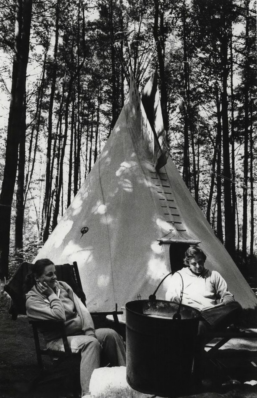 Tipi camping in the Adirondack Mountain, New York - Patricia Suitto Undated (left) and husband, Jack, sit before morning campfire at Northampton Beach state campsite in Fulton County on Aug. 16, 1982 (Art Markey/Times Union Archive)