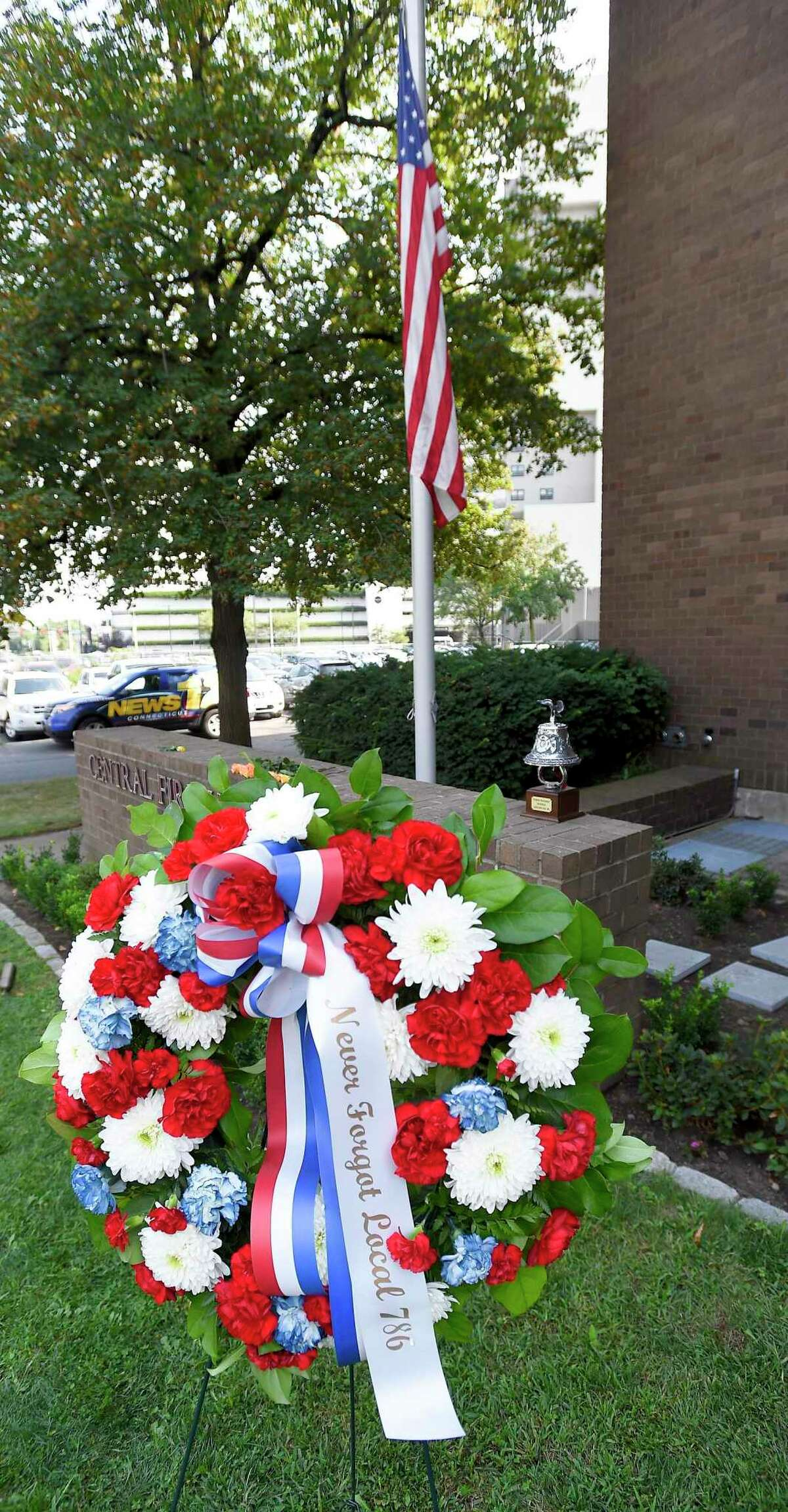 A memorial wreath to honor victims is placed following a 9/11 Remembrance Ceremony on Sept. 11, 2019 at the Central Fire Headquarters in Stamford, Connecticut.