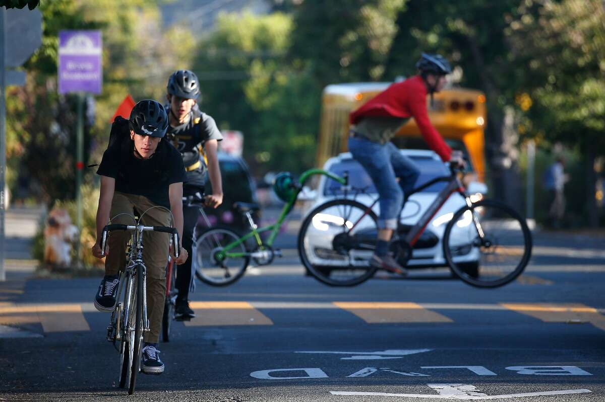 Cyclists cross paths at Milvia and Virginia streets in Berkeley, Calif. on Wednesday, Sept. 11, 2019. Berkeley Police are issuing $300 citations to bicyclists who blow through stop signs or red lights.