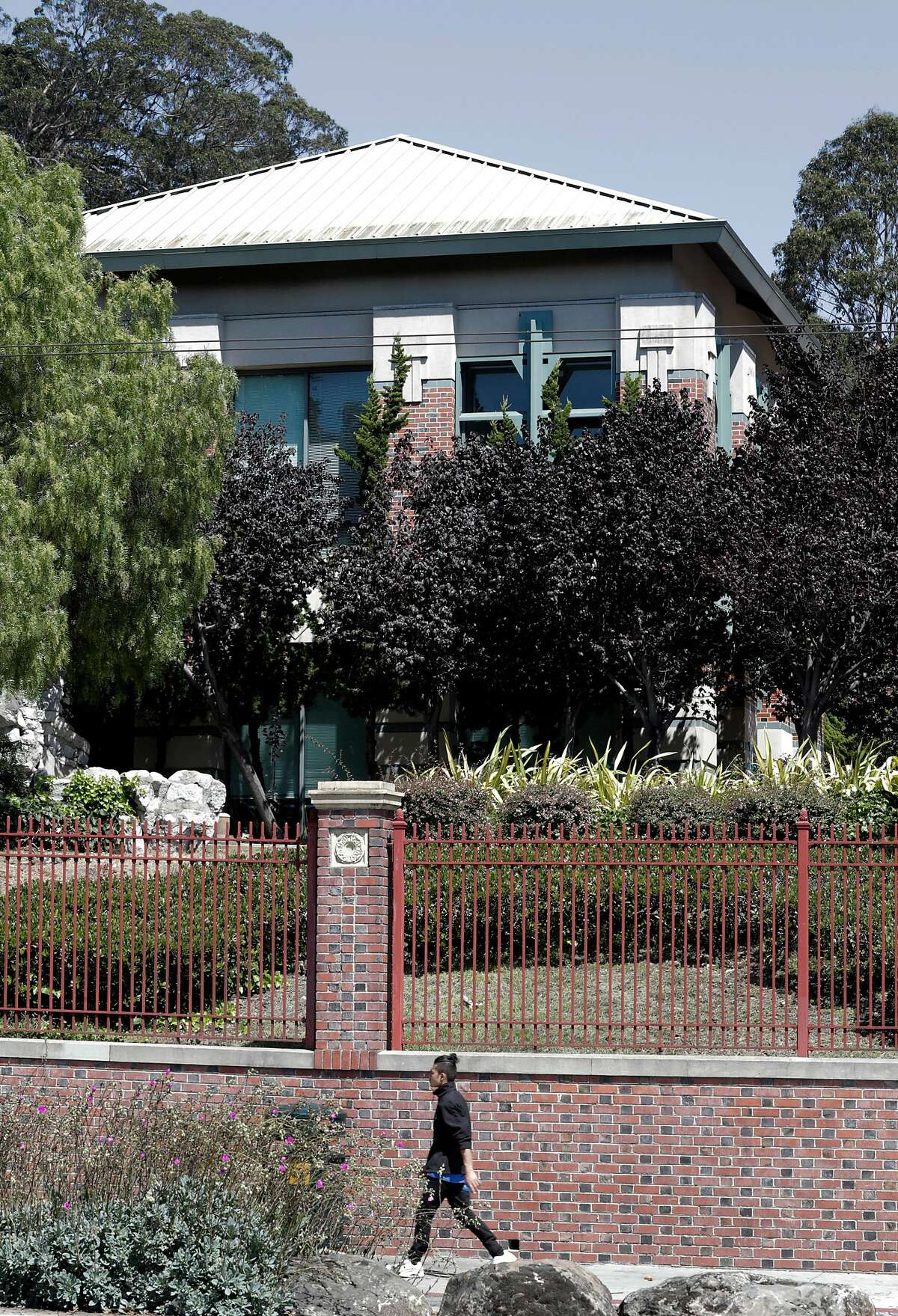 A pedestrian walks by the San Francisco Adult Residential mental health services on Potrero Avenue in San Francisco, Calif., on Wednesday, August 21, 2019. The city will be removing 'mental health beds' from the facility which offers long-term mental health beds to people and moving the beds to Hummingbird Place which offers more short-term mental health beds.