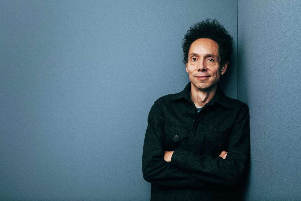 FILE A?' Malcolm Gladwell, the author, in New York, May 11, 2017. He is one of 50 writers profiled in Terry NewmanA?•s new book A?'Legendary Authors and the Clothes They Wore,A?