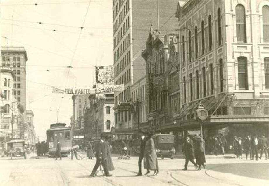 "Main Street, Houston about 1920, shows a street car and Foley Bros. Roggen on what Houston was like while he was growing up: ""It still had the street cars, and it still had the inexpensive restaurants. The major shopping was Foleys."" Photo: UNKNOWN / Houston Chronicle / Houston Chronicle"