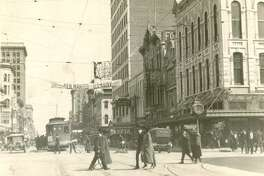 "Main Street, Houston about 1920, shows a street car and Foley Bros. Roggen on what Houston was like while he was growing up: ""It still had the street cars, and it still had the inexpensive restaurants. The major shopping was Foleys."""