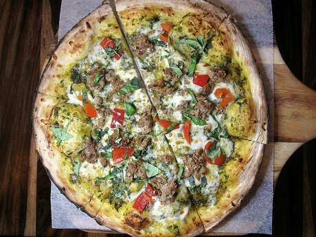 The Mob Boss pizza includes housemade fennel sausage, Calabrian pepper pesto, housemade mozzarella cheese, Calabrese peppers and basil at 188 South.