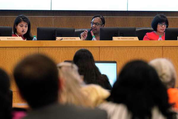 In this August file photo, from left, Houston ISD Trustee Elizabeth Santos, Interim Superintendent Grenita Lathan and Board President Diana Dávila are shown during the Houston ISD school board meeting at Hattie Mae White Educational Support Center.