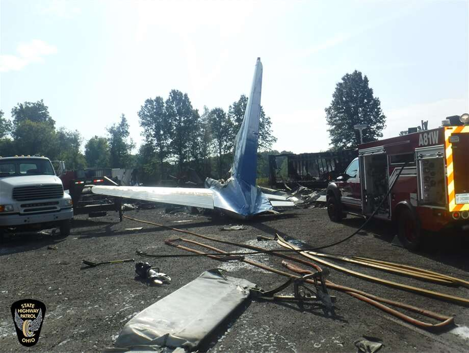 The wreckage from a small cargo plane crash at an auto repair business near Toledo Express Airport Wednesday, Sept. 11, 20129, in Monclova, Ohio. Photo: Courtesy