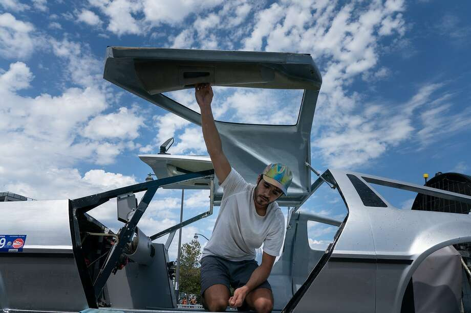 Matt Riese closes the door on his DeLorean hovercraft for transport in S.F. Photo: Paul Kuroda / Special To The Chronicle