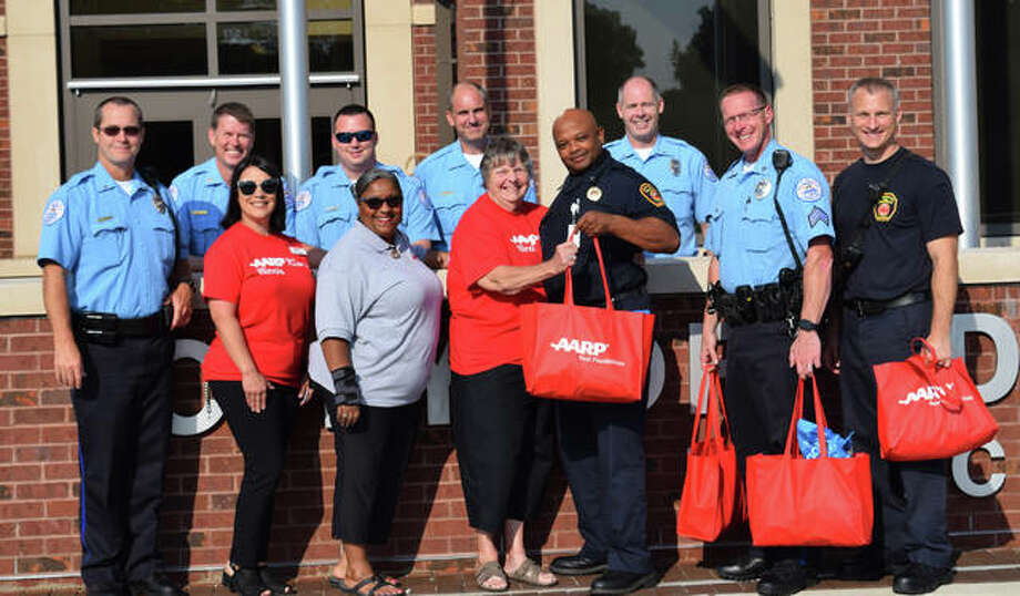 AARP interim associate state director of Southern Illinois/Metro-East Region Teresa Jones (grey) and AARP members Theresa Collins (left) and Sandy Townzen deliver thank-you bags to Edwardsville police officers and firefighters on 9/11/19. Photo: Tyler Pletsch | The Intelligencer