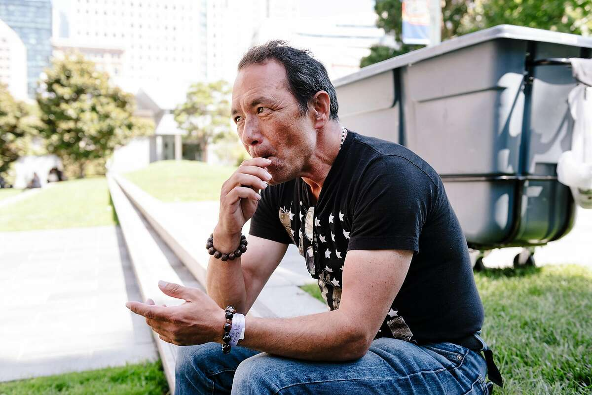 John Petitt uses a Juul vape pen while sitting in Yerba Buena Gardens in San Francisco, Calif. on Wednesday, Sept. 11, 2019. John started using a Juul vaporizer 2 years ago to help him quit his 30 year addiction to smoking cigarettes.
