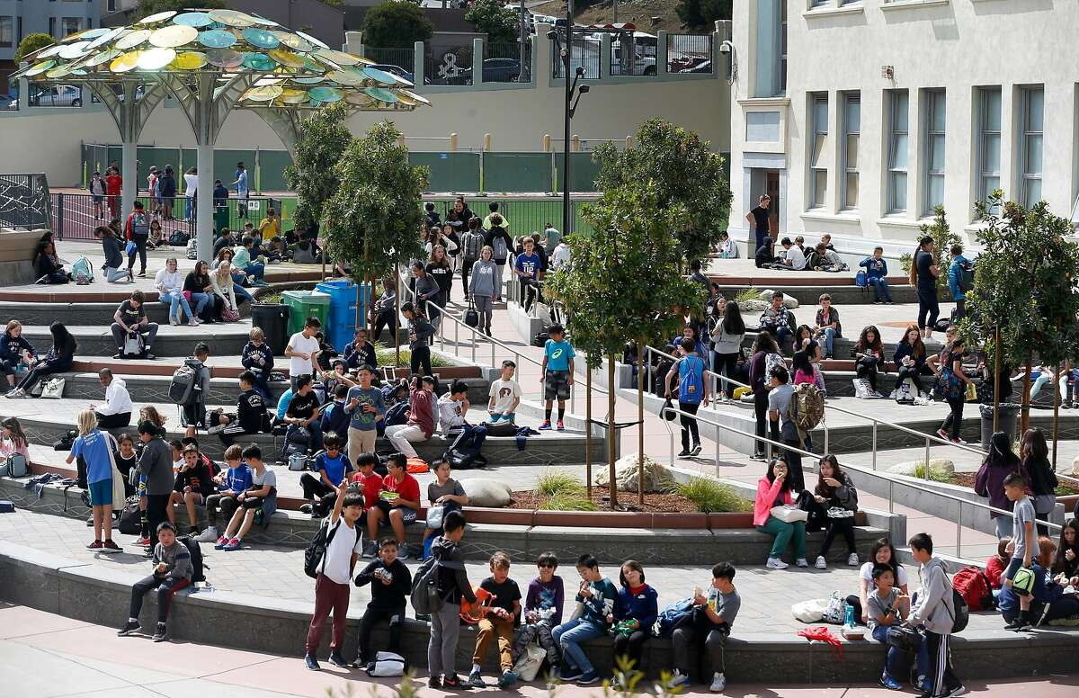Students at Presidio Middle School congregate in the newly renovated schoolyard during the lunch break in San Francisco, Calif. on Tuesday, Sept. 10, 2019. Salesforce provided funds to refurbish and upgrade the schoolyard and library.
