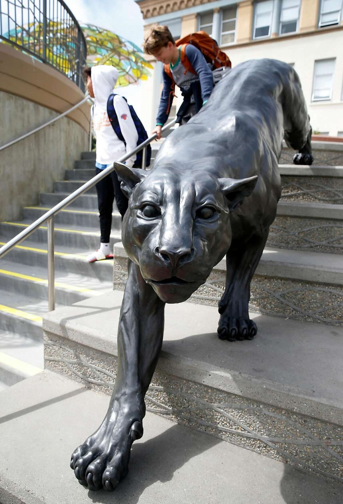 Presidio Middle School students gather near a sculpture of a panther, the school's mascot, installed in the newly renovated schoolyard during the lunch break in San Francisco, Calif. on Tuesday, Sept. 10, 2019. Salesforce provided funds to refurbish and upgrade the schoolyard and library.
